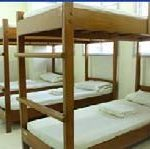 photo of dormitory with 3 sets of bunk beds