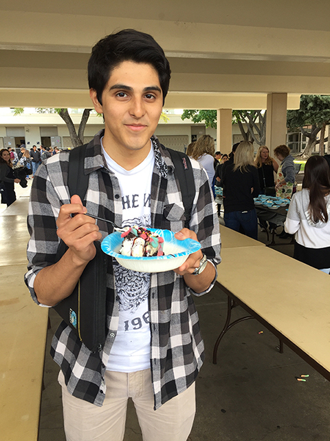 Ernesto Mendoza enjoying his ice sundae at the Honor Roll ice cream social.